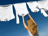 Longhaired Girl, Blue Sky And White Laundry