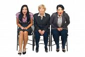 picture of shock awe  - Shocked group of businesswomen sitting on chair at conference isolated on white background - JPG