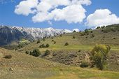 pic of colorado high country  - peaks over wooded foothills on mcclure pass colorado - JPG