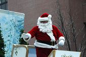 santa claus comes to town in the local holiday parade.