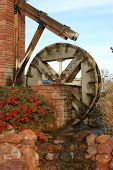stock photo of water-mill  - a beautifully crafted water mill graces a city park in st - JPG