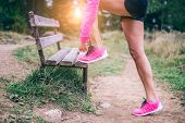 ������, ������: Woman Tying Running Shoes