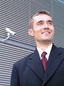 image of modern building  - businessman outside a modern office building - JPG