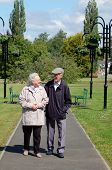 Senior couple strolling in the park