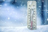Thermometer On Snow Shows Low Temperatures - Zero. Low Temperatures In Degrees Celsius And Fahrenhei poster