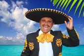 Charro mariachi portrait singing shout in Mexico Caribbean beach