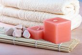Red Candles And Towel With Peach Background