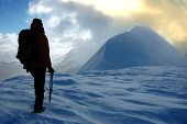 picture of mountain-climber  - A lonely climber reaching an high mountain pass - JPG