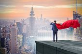 Super hero businessman  on top of building ready for challenge poster