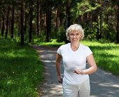 picture of elderly woman  - Elderly woman likes to run in the park - JPG