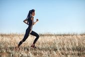 Asian Girl In Sportswear Running Across Field, Morning Workout poster