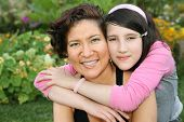 pic of mother daughter  - Daughter huging her mother in a park - JPG