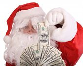 Santa Claus holding money. Isolated.