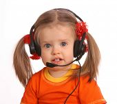 Portrait of child with headset. White background.