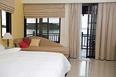 Luxury bedroom with view of  sea. Ecotourism.