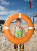 Childl with  life buoy at coast. Ecotourism.