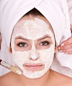 Cosmetician make  mask to  girl. Facial massage. poster