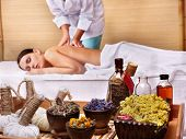 stock photo of massage therapy  - Young beautiful woman on massage table in beauty spa - JPG