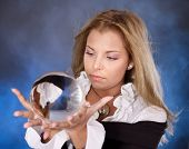 image of witch ball  - Young beautiful woman with crystal ball - JPG