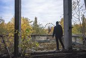 Постер, плакат: Men On The Top Of The Roof At Abandoned Pripyat City In Chernobyl Exclusion Zone At Autumn Time