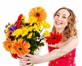 Happy young woman holding red flowers. Isolated.