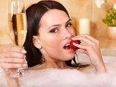 image of hot-tub  - Woman swimming of bath tub - JPG