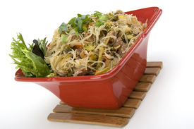 picture of pancit  - Pancit in a Red Ceramic dish with Garnish - JPG