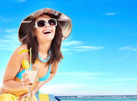 picture of beach holiday  - Girl in bikini drink juice through a straw - JPG