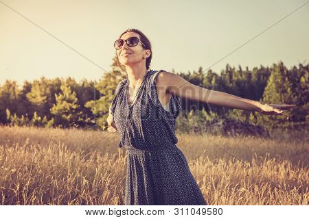 poster of Running in sunset. Lifestyle concept. Hipster woman running in sunset in meadow. Healthy lifestyle. People lifestyle. Hipster people lifestyle. Running. People. LIfestyle.