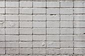 stock photo of arriere-plan  - white roughly textured brick wall painted with white paint - JPG