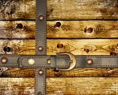 Grunge background. Old wooden boards and leather belt