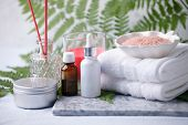 Beauty And Fashion Concept With Spa Set On Marble Plate, Sea Salt, Aroma Oil, Aroma Stick, Cotton To poster