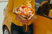 Woman In Yellow Blouse With Gentle Bouquet Of Yellow Roses Near Yellow Car poster