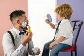 Barbershop. Trendy And Stylish Father And Son. Barber Shaving A Bearded Man In A Barber Shop. Barber poster