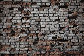 Old Brick Wall Texture. The Wall, Made Of Old Red Bricks, Darkened By Old Age. Ancient Vintage Brick poster