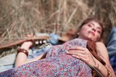 Beautiful Hippie Woman Sleeping On The Grass. poster