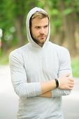 Seriousness And Masculinity. Sportswear Fashion. Sportsman Relax After Training Outdoor. Handsome Un poster