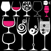 wine glasses silhouettes isolated on black background