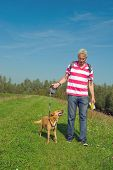 picture of bagpack  - walking the dog at the top of the hill - JPG