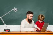 Ffather Teaching Her Son In Classroom At School. Teacher Teaches A Student To Use A Microscope. Dad  poster