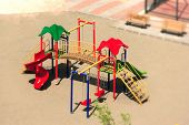stock photo of swingset  - an elevated view of slides and swings in the park - JPG
