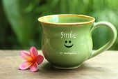 Cup Of Coffee. Cup Of Tea. With A Smile Of Smiling Emoticon On It And Beautiful Pink Balinese Frangi poster