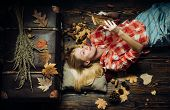 Girl In Autumn In A Seasonal Clothes Whith Golden Leaf. Beautiful Sensual Blonde. Autumn Woman Holdi poster