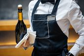 Waiter In A Restaurant With A Bottle Of Prosecco poster