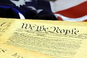 stock photo of preamble  - Preamble to the Constitution of the United States and American Flag.