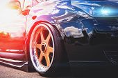 Close Up Of Headlight And Car Wheel With Custom Disk Of Tuned Low Rider Sport Car, Toned poster