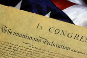 stock photo of preamble  - Constitution of the United States and American Flag, We The People... ** Note: Shallow depth of field - JPG