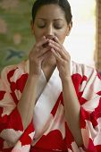 stock photo of african american woman  - Woman in kimono drinking tea - JPG