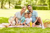 family, leisure and people concept - portrait of happy mother, father and two little sons having pic poster
