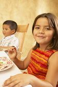 Young Hispanic girl at dinner table